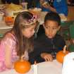 Mikayla Johnston and Che Stiggers decorate pumpkins at the Family Fall Festival at First Christian Church in Guthrie last Sunday.  Community Photo By:  Sharon Johnston  Submitted By:  Karen,