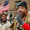 Khepra Khem from the Evangelistic Church leads the crowd in singing a Negro spiritual that was frequently sung by marchers in the 1960s civil rights movement.  Khem and others were gathered in front of the Freedom Center at one of several events in the Oklahoma City area that allowed local residents to observe the national holiday honoring slain civil rights leader, Dr. Rev. Martin Luther King, Jr. on Monday, Jan. 16,  2012,  At left is Orlando Fowlkes.   Photo by Jim Beckel, The Oklahoman