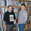 Jeremy Short, left, and Aaron McKenny pose with the graphic novel