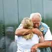 Veteran Paul Jones, of Guthrie, hugs his daughter Allison Robinson, after he looks up names on the Dignity Memorial Vietnam Wall at Reaves Park in Norman on Sunday, July 4, 2010. Photo by John Clanton, The Oklahoman