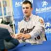 Jordan Lyles, a 20-year-old pitcher, signs autographs during the Astros caravan stop at Academy Sports and Outdoors in south Oklahoma City on Wednesday.  Photo by John Clanton, The Oklahoman
