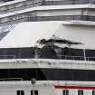The Carnival cruise ship Triumph is damaged after the being dislodged from its mooring at BAE shipyard during high winds Wednesday, April 3, 2013 in Mobile, Ala. Triumph was disabled Feb. 10 by an engine fire that stranded thousands of passengers onboard for days in the Gulf. It was towed into port in Mobile. (AP Photo/AL.com, Bill Starling)  MAGS OUT
