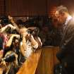 Photographers take photos of Olympic athlete Oscar Pistorius as he stands in the dock during his bail hearing at the magistrates court in Pretoria, South Africa, Friday, Feb. 22, 2013. The fourth and likely final day of Oscar Pistorius' bail hearing opened on Friday, with the magistrate then to rule if the double-amputee athlete can be freed before trial or if he has to remain in custody over the shooting death of his girlfriend. (AP Photo/Themba Hadebe)