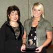 """Feed the Children employees Lynda Merchant and Chelsi Pittman accept the 2007 Volunteer Site of the Year Award from MNTC's HIRE Program at the """"Celebration of Success"""" event held at Moore Norman Technology Center's South Penn Campus.  Community Photo By:  Judy Mosley, MNTC  Submitted By:  Anna, Norman"""