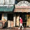 Jim Mears, General Manager of Lucille's Restaurant & Bar surveys the damage from an overnight fire in Mulhall, Oklahoma September 2, 2009. Photo by Steve Gooch, The Oklahoman