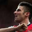 Arsenal's Olivier Giroud celebrates his goal during their English Premier League soccer match against Newcastle United at St James' Park, Newcastle, England, Sunday, Dec. 29, 2013. (AP Photo/Scott Heppell)