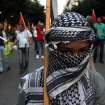 A Palestinian boy who lives in Greece takes part in a rally in the northern Greek port of Thessaloniki, on Thursday, July 17, 2014.  Hundreds people took part in protest organized by pro-communist union PAME against air-strikes on the Gaza strip. (AP Photo/Nikolas Giakoumidis)