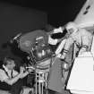 FILE - In this June 4, 1965 file photo, from left, cameraman Sam Rosen and director Gero Nelson guide the co-star of the series