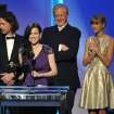 From left, John Paul White, Joy Williams, T Bone Burnett and Taylor Swift accept the award for song written for visual media for