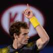 Britain's Andy Murray gestures for a video replay of a line call during his men's semifinal against Switzerland's Roger Federer at the Australian Open tennis championship in Melbourne, Australia, Friday, Jan. 25, 2013. (AP Photo/Andrew Brownbill)