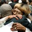 Daughter Marilyn Luper Hildreth is hugged by her brother, Calvin Luper, when she returned to her seat after delivering remarks about their mother. About 2,500 people celebrated the life and legacy of Oklahoma City civil rights pioneer Clara Mae Shepard Luper  during a lively service in the Cox Convention Center that lasted more than three hours, Friday,  June 17, 2011.  Luper died  last week at the age of 88. Photo by Jim Beckel, The Oklahoman