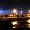 Lightning rips through the sky behind the Kimberly Clark plant in Paris, Texas Monday, March 19, 2012 as severe thunderstorms moved through North East Texas dumping inches of rain and heavy winds along the way. (AP PHOTO/The Paris News, Sam Craft)