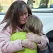 A mother hugs her daughter following a shooting at the Sandy Hook Elementary School in Newtown, Conn., about 60 miles (96 kilometers) northeast of New York City, Friday, Dec. 14, 2012. An official with knowledge of Friday's shooting said 27 people were dead, including 18 children. It was the worst school shooting in the country's history. (AP Photo/The New Haven Register, Melanie Stengel)   ORG XMIT: CTNHR103