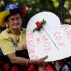A supporter of Venezuela' s President Hugo Chavez holds up a sign that reads in Spanish