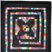 This mini quilt made by Audrey Arno of Tuttle is titled