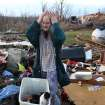 Donna Sebastian stands amidst the rubble of her home on Carlisle Road Friday, March 2, 2012 in Boone County, Ky. Powerful storms stretching from the Gulf Coast to the Great Lakes flattened buildings in several states, wrecked two Indiana towns and bred anxiety across a wide swath of the country in the second powerful tornado outbreak this week.  (AP Photo/The Cincinnati Enquirer, Patrick Reddy) MANDATORY CREDIT;  NO SALES   ORG XMIT: OHCIN107