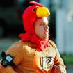 Wearing a turkey costume, Devon McNew of McLoud, nears the end of the 5K run as he sprints along Boulevard   during the annual Turkey Trot in downtown Edmond Thursday morning,  Nov. 24, 2011.  He said it was his first time to participate in the Turkey Trot .  Photo by Jim Beckel, The Oklahoman