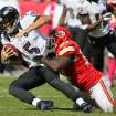 Baltimore Ravens quarterback Joe Flacco (5) is sacked by Kansas City Chiefs defensive end Allen Bailey (97) during the 4th quarter of an NFL football game, Sunday, Oct. 7, 2012, in Kansas City, MO. (AP Photo/Colin E Braley)