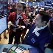Specialist Vincent Surace, foreground, works with traders at his post on the floor of the New York Stock Exchange Friday, Aug. 16, 2013. Stocks bounced back Friday from consecutive days of significant declines, with more evidence of a rebounding U.S. housing market. (AP Photo/Richard Drew)