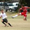 ESC 90 player Nathan Johnson defends a TSC player Saturday during the Beat the Heat Tournament in Edmond, OK.  Community Photo By:  Jeff Wilson  Submitted By:  Jeff, Edmond