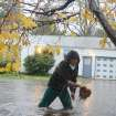 Ray Lunt wades in high water to clean out the storm drains on Nob Hill Street SE in Salem, Ore., on Monday, Nov. 19, 2012. (AP Photo/Statesman-Journal, Danielle Peterson)