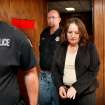 Bobbi Parker is taken in handcuffs from the courtroom after being found guilty. Behind her is Greer County Sheriff  Devin Huckabay.  Jurors returned a guilty verdict and recommended a one-year sentence to punish Bobbi Parker on a charge of aiding prison inmate Randolph Dial escape from the Oklahoma State Reformatory in 1994. Dial died in 2007.   Parker is led from the the Greer County Courthouse in Mangum , Okla. and taken to the county jail where she will be held until her sentencing.  The verdict was given about 2:30 Wednesday afternoon, Sep. 21, 2011. Photo by Jim Beckel, The Oklahoman
