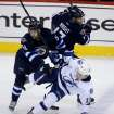 Winnipeg Jets' Eric O'Dell (58) and James Wright (17) collide with Tampa Bay Lightning's Ondrej Palat (18) during the first period of an NHL hockey game Tuesday, Jan. 7, 2014, in Winnipeg, Manitoba. (AP Photo/The Canadian Press, Trevor Hagan)