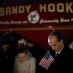Mourners listen to a memorial service over a loudspeaker outside Newtown High School for the victims of the Sandy Hook Elementary School shooting, Sunday, Dec. 16, 2012, in Newtown, Conn. (AP Photo/David Goldman) ORG XMIT: CTDG130
