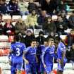 Chelsea's captain Frank Lampard, center, celebrates his goal with his teammates during their English League Cup quarterfinal soccer match against Sunderland at the Stadium of Light, Sunderland, England, Tuesday, Dec. 17, 2013. (AP Photo/Scott Heppell)