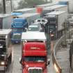 Cars and trucks are stopped Monday in eastbound lanes of I-44 near the Belle Isle Bridge. Torrential rain caused flooding in Oklahoma City.  Photo by by Jim Beckel, The Oklahoman