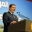 In this Monday, June 10, 2013, photo released by the Egyptian Presidency, Egypt's President Mohammed Morsi speaks on Ethiopia's Nile dam project at a conference in Cairo. Morsi on Monday hardened his stance against Ethiopia and its construction of a Nile dam, warning that