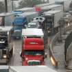 FLASH FLOODS / TORRENTIAL RAIN / FLOOD / FLOODING / INTERSTATE 44: Cars and trucks are stopped in eastbound lanes of I-44 near the Belle Isle Bridge. Torrential rain caused flooding in Oklahoma City, Monday, June 14, 2010.     by Jim Beckel, The Oklahoman ORG XMIT: KOD