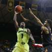 Baylor guard Kenny Chery (1) shoots over Oklahoma State guard/forward Le'Bryan Nash (2), right, in the second half of an NCAA college basketball game, Monday, Feb. 17, 2014, in Waco, Texas. (AP Photo/Waco Tribune Herald, Rod Aydelotte)