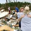 Standing in the middle of her destroyed home, Shelley Heston Bolles gets a hug from a family member in Little Axe, Oklahoma on Tuesday, May 11, 2010. By John Clanton, The Oklahoman