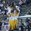 Wyoming's Robert Herron (6) celebrates his touchdown reception with Chris McNeill (80) during the first half of an NCAA college football game in Reno, Nev., on Saturday, Oct. 6, 2012. (AP Photo/Cathleen Allison)