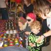 Zachary Connelly and mother, Kelly Connelly play the Penny Toss Game at the Family Fall Festival at First Christian Church in Guthrie.  Community Photo By:  Sharon Johnston  Submitted By:  Karen,