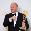 Louis C.K. poses with the award for Outstanding Writing for a Comedy Series in the press room at the 66th Annual Primetime Emmy Awards at the Nokia Theatre L.A. Live on Monday, Aug. 25, 2014, in Los Angeles. (Photo by Jordan Strauss/Invision/AP)