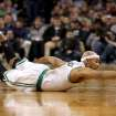 Boston Celtics point guard Jerryd Bayless dives for a loose ball during the first half of an NBA basketball game against the Sacramento Kings, Friday, Feb. 7, 2014, in Boston. (AP Photo/Mary Schwalm)
