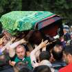 People bear a coffin aloft, of one mine accident victim for burial in Soma, Turkey, Wednesday, May 14, 2014.   Nearly 450 miners were rescued, the mining company said, but the fate of an unknown number of others remained unclear as bodies are still being brought to the surface and burials are underway after one of the world's deadliest mining disasters.(AP Photo/Emre Tazegul)