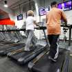Members work out on treadmills place in front of a bank of televisions in the newly opened YMCA on southwest corner of Rockwell and Northwest Highway on  Monday, January 9, 2012,  .  Photo by Jim Beckel, The Oklahoman