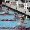 Breonna Barker (second from right), of Broken Arrow, watches the scoreboard after her win in the 50-yard freestyle during the Class 6A swim finals, at the Jenks Trojans Aquatics Center, in Jenks, on Saturday, Feb. 16, 2013. CORY YOUNG/Tulsa World ORG XMIT: DTI1302161713278768