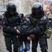 Riot policemen detain a participant of an opposition march in Nizhny Novgorod, about 400 km (200 miles) east of Moscow, on Sunday, Nov. 4, 2012. The march took place on Unity Day, a national holiday established in 2005 to replace commemorations of Bolshevik Revolution. (AP photo/ Mitya Aleshkovskiy)