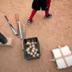 A boy walks near bats and baseballs during practice at the field where Detroit Tigers' Miguel Cabrera learned to play, in Maracay, Venezuela, Friday, March 28, 2014. Residents of this hardscrabble neighborhood say the grounded superstar is a model for local youth, who must navigate a more treacherous path than he did. They remember Cabrera as a single-minded child who only put down the bat to study, and stayed home most nights.  (AP Photo/Alejandro Cegarra)
