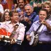 "** ADVANCE FOR WEEKEND EDITIONS, MAY 15-16 ** FILE ** Co-hosts Buck Owens, left, and Roy Clark, right, perform with other cast members during a taping of ""Hee Haw"" in 1986 in Nashville, Tenn. Time-Life is releasing full ""Hee Haw"" shows for the first time on VHS and DVD for the 35th anniversary of the show's first season. Shown between Owens and Clark is actor Ernest Borgnine, a guest on that episode. (AP Photo/Mark Humphrey)"