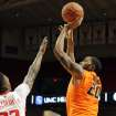 Oklahoma State's Michael Cobbins (20) shoots over Texas Tech's Jamal Williams Jr., (23) during their NCAA college basketball game, Wednesday, Feb. 13, 2013, in Lubbock, Texas. (AP Photo/The Avalanche-Journal, Zach Long) ALL LOCAL TV OUT ORG XMIT: TXLUB106