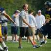 West Virginia University college football head coach Dana Holgorsen, center, watches his team run drills during NCAA college football practice in Morgantown, W.Va. on Friday, August 5, 2011. (AP Photo/David Smith) ORG XMIT: WVDS104
