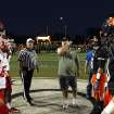 Greg Wampler tosses the coin before the Lawton - Norman High School football game at Harve Collins Field at Norman High School in Norman Friday night. PHOTO BY HUGH SCOTT FOR THE OKLAHOMAN ORG XMIT: KOD