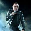 Bono performs onstage during the U2 360 opener at the Camp Nou stadium on June 30, 2009 in Barcelona, Spain. ORG XMIT: 00000000