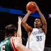 Kevin Durant (35) of the Thunder takes a shot during the NBA basketball game between the Oklahoma City Thunder and the Milwaukee Bucks at the Ford Center in Oklahoma City, Wednesday, Oct. 29, 2008. This was the regular season debut of the Thunder. BY NATE BILLINGS, THE OKLAHOMAN