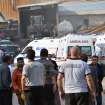 Rescue workers and ambulances at the entrance of the mine after an explosion and fire at a coal mine in Soma, in western Turkey, Tuesday, May 13, 2014.  An explosion and fire at a coal mine in western Turkey killed at least one miner Tuesday and left up to 300 workers trapped underground, a Turkish official said. Twenty people were rescued from the mine in the town of Soma in Manisa province but one later died in the hospital, Soma administrator Mehmet Bahattin Atci told reporters. The town is 250 kilometers (155 miles) south of Istanbul. (AP Photo/IHA) TURKEY OUT